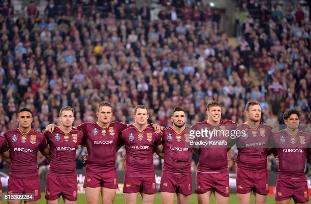 Queensland players embrace before game three of the State Of Origin series between the Queensland Maroons and the New South Wales Blues at Suncorp...