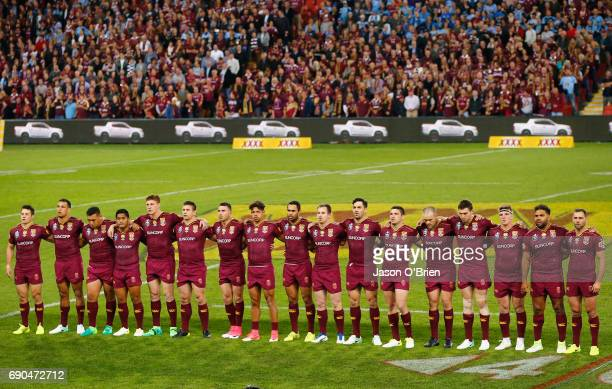 Queensland players line up during game one of the State Of Origin series between the Queensland Maroons and the New South Wales Blues at Suncorp...