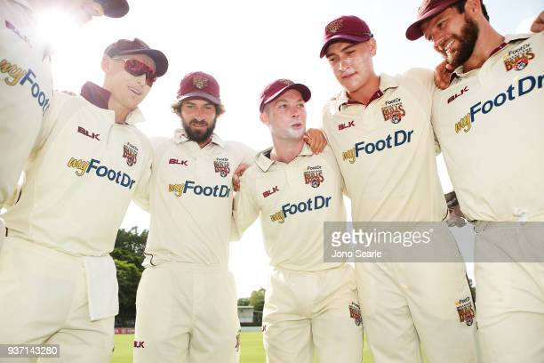 Queensland players Marnus Labuschagne Joe Burns captain Jimmy Peirson Matthew Renshaw and Michael Neser get in a huddle before heading out to bowl...