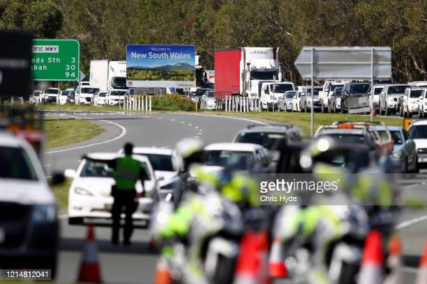 Queensland Police stop vehicles at a Police checkpoint set up at the Queensland and New South Wales border in Coolangatta on March 26, 2020 on the...