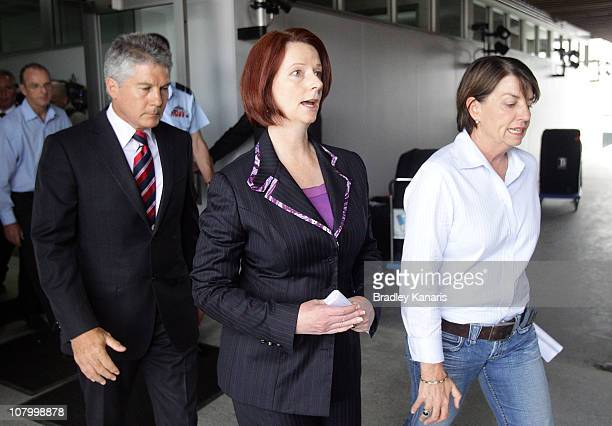 Queensland Premier Anna Bligh and Prime Minister Julia Gillard leave after speaking at a media conference in the suburb of Kedron on January 12 2011...