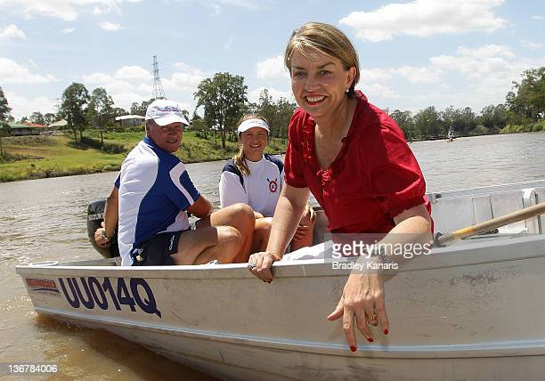 Queensland Premier Anna Bligh poses for a photo on a boat on the Brisbane River after visiting members of the Centenary Rowing Club which was hard...