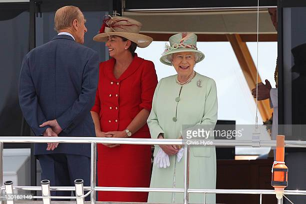 Queensland Premier Anna Bligh Prince Philip Duke of Edinburgh and Queen Elizabeth II enjoy a river cruise on the Brisbane river October 24 2011 in...