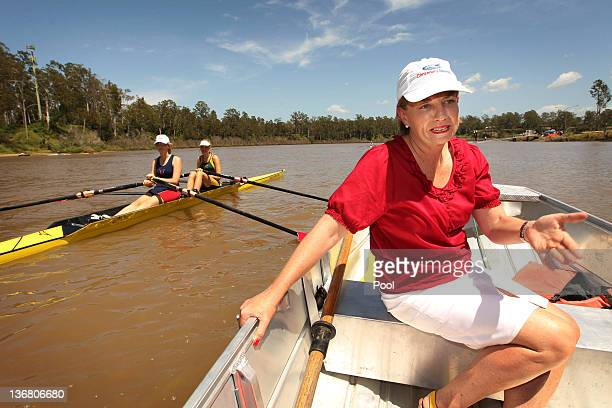 Queensland Premier Anna Bligh rides on a boat on the Brisbane River after visiting members of the Centenary Rowing Club which was hard hit by the...