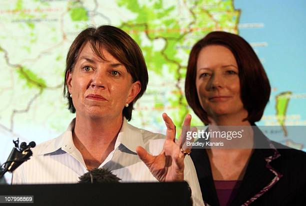 Queensland Premier Anna Bligh speaks with Prime Minister Julia Gillard at a media conference in the suburb of Kedron on January 12 2011 in Brisbane...