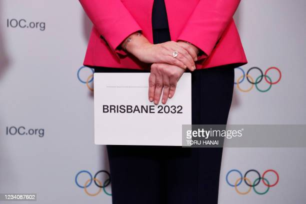 Queensland Premier Annastacia Palaszczuk holds the queue card after Brisbane was announced as the 2032 Summer Olympics host city during the 138th IOC...