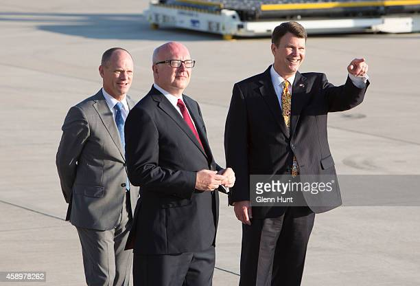 Queensland Premier Campbell Newman AttorneyGeneral for Australia George Brandis and US ambassador to Australia John Berry wait on the tarmac at...
