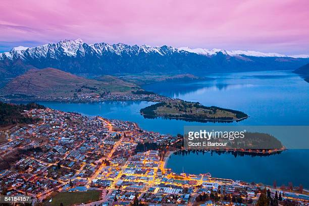 queenstown and 'the remarkables' mountain range    - queenstown stock pictures, royalty-free photos & images