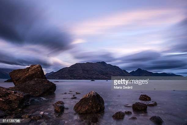 Queenstown - Moving Clouds with Rocks at Sunset