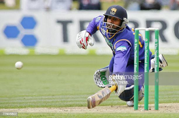 Queenstown, NEW ZEALAND: Sri Lankan batsman Chamara Silva dives into his crease to avoid a run out during the second One Day International match...