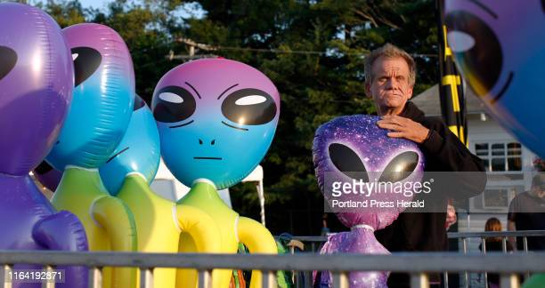 Quentin Barber inflates a novelty alien to arrange alongside the other prizes at the Kiddie Striker a hammerandbell strength test for children on...