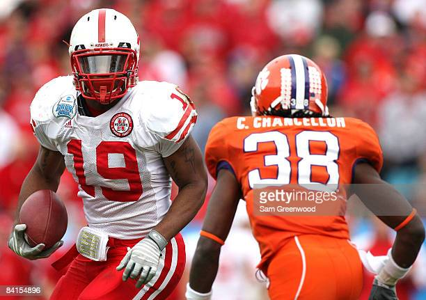 Quentin Castille of the Nebraska Cornhuskers attempts to allude the tackle of Chris Chancellor of the Clemson Tigers during the Konica Minolta Gator...