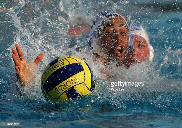 Quentin Chipotel of France and Kevin Graham of Canada battle for possession of Mikasa ball during FINA World League semifinal at the USA Water Polo...