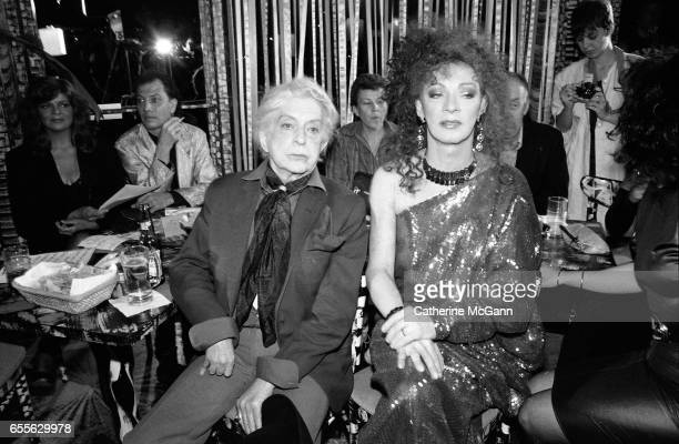 Quentin Crisp and Holly Woodlawn pose for a photo at an event in New York City, New York.