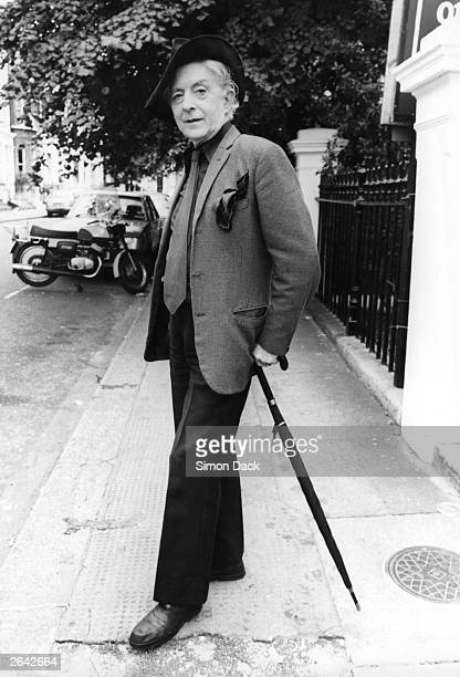 Quentin Crisp author of 'The Naked Civil Servant' poses near his Chelsea bedsit