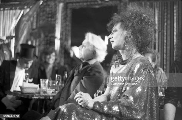 Quentin Crisp , center, and Holly Woodlawn , right, at an event in June 1988 in New York City, New York.