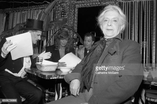 Quentin Crisp , right, poses for a photo at an event in New York City, New York.