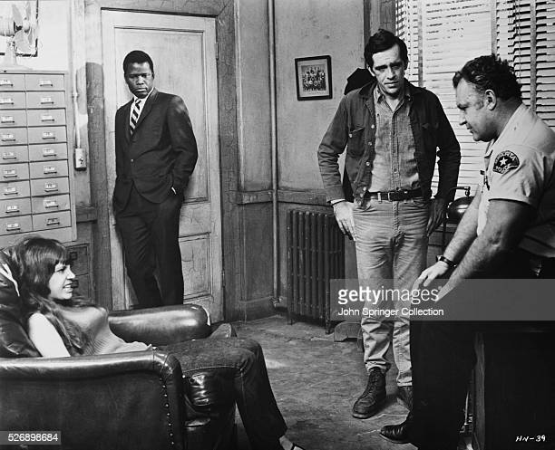 Quentin Dean as Delores Sidney Poitier as Virgil Tibbs Warren Oates as Sam Wood and Rod Steiger as police chief Bill Gillespie in the 1967 film In...