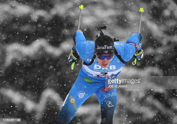 Quentin Fillon Maillet of France competes during the men's 12,5km pursuit during IBU Biathlon World Cup in Hochfilzen, Austria, on December 12, 2020.