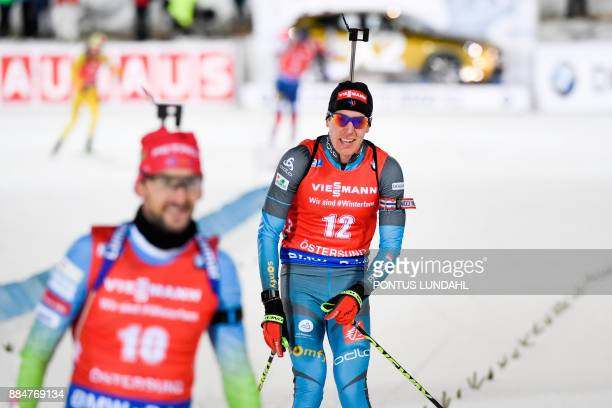 Quentin Fillon Maillet of France crosses the finish line to finish third at the end of the men's 125 km pursuit event at the IBU World Cup Biathlon...