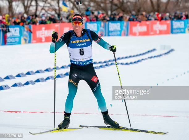 Quentin Fillon Maillet of France crosses the finish line to win the men's 125 KM pursuit of the IBU World Cup Biathlon February 16 2019 at Soldier...