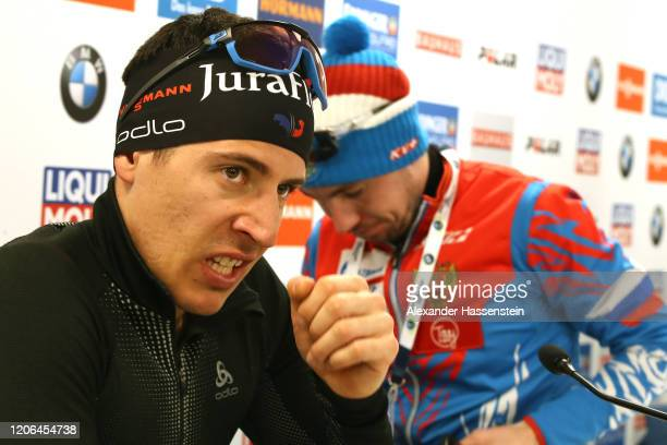 Quentin Fillon Maillet of France looks on with Alexander Loginov of Russia after a press conference after the Men 10 km Sprint Competition at the IBU...