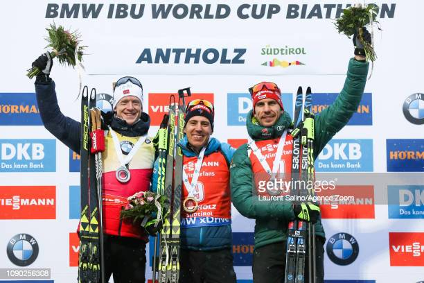 Quentin Fillon Maillet of France takes 1st place, Johannes Thingnes Boe of Norway takes 2nd place, Arnd Peiffer of Germany takes 3rd place during the...