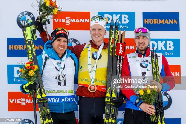 Quentin Fillon Maillet of France takes 2nd place Johannes Thingnes Boe of Norway takes 1st place Alexander Loginov of Russia takes 3rd place during...