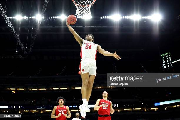 Quentin Grimes of the Houston Cougars dunks the ball during the second half against the Rutgers Scarlet Knights in the second round game of the 2021...