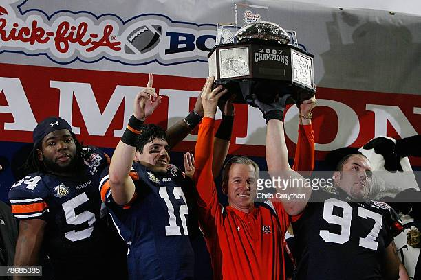 Quentin Groves quarterback Brandon Cox head coach Tommy Tuberville and Josh Thompson of the Auburn University Tigers celebrate with the winner's...