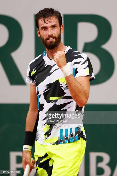 Quentin Halys of France celebrates after winning a point during his Men's Singles first round match against Marcos Giron of the United States on day...