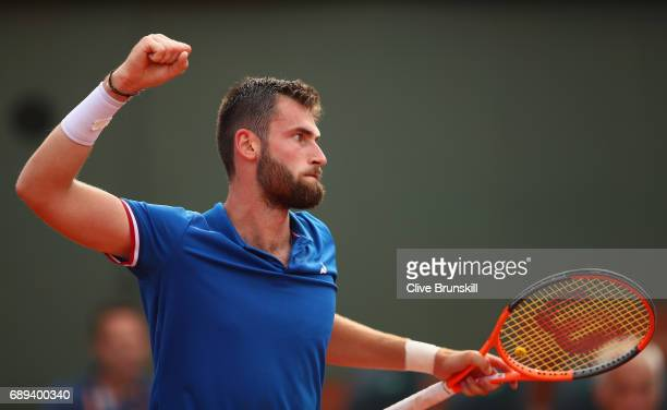 Quentin Halys of France celebrates during the mens singles first round match against Marco Trungelitti of Argentina on day one of the 2017 French...