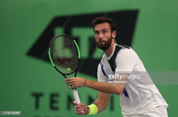 Quentin Halys of France is seen in action against Daniel Masur of Germany in their third round match during day four of The Murray Trophy at...