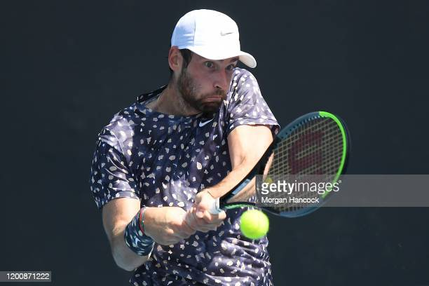 Quentin Halys of France plays a backhand during his Men's Singles first round match against Filip Krajinovic of Serbia on day two of the 2020...