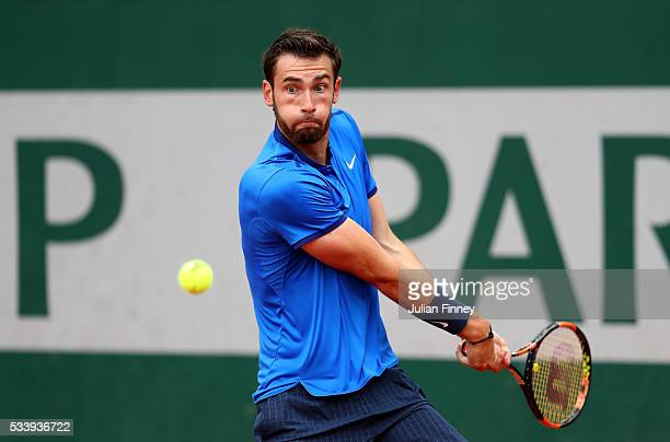 Quentin Halys of France plays a backhand during the Men's Singles first round match against Hyeon Chung of Korea on day three of the 2016 French Open...