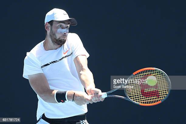 Quentin Halys of France plays a backhand in his first round match against Sam Querry of the United States on day one of the 2017 Australian Open at...