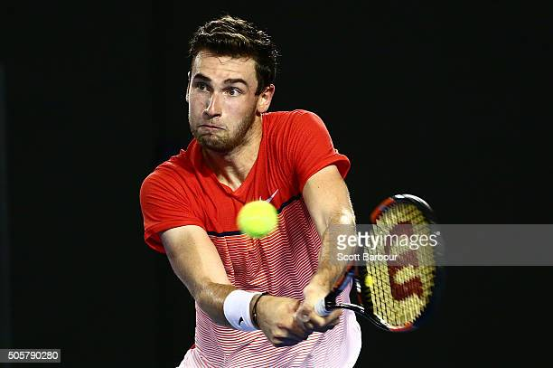 Quentin Halys of France plays a backhand in his second round match against Novak Djokovic of Serbia during day three of the 2016 Australian Open at...