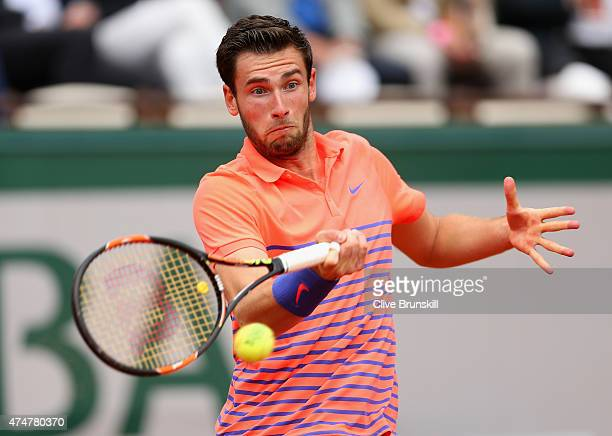 Quentin Halys of France plays a forehand during his Men's Singles match against Rafael Nadal of Spain on day three of the 2015 French Open at Roland...
