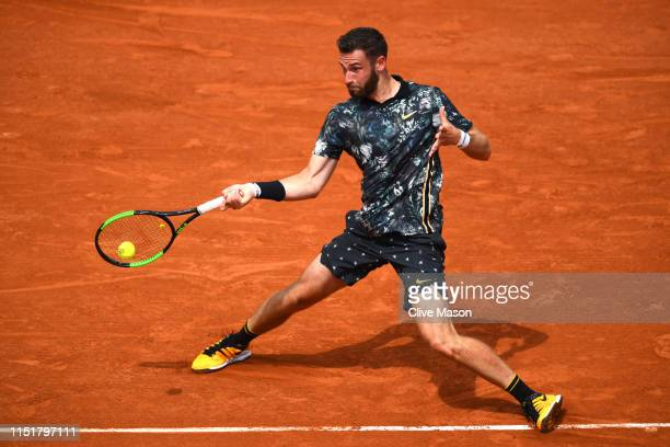 Quentin Halys of France plays a forehand in his mens singles first round match against Kei Nishikori of Japan during Day one of the 2019 French Open...