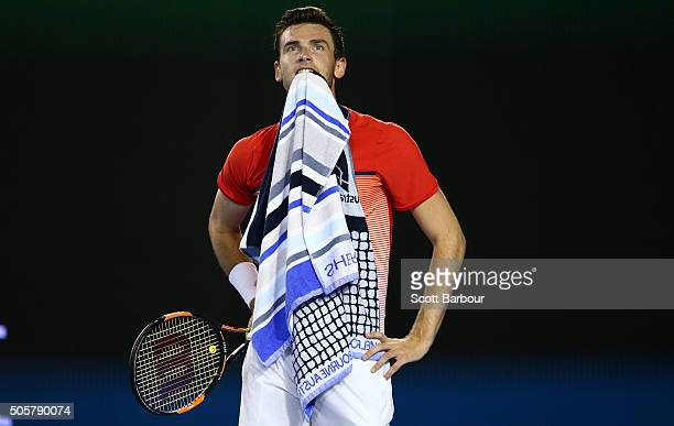 Quentin Halys of France reacts in his second round match against Novak Djokovic of Serbia during day three of the 2016 Australian Open at Melbourne...