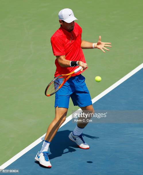 Quentin Halys of France returns a forehand to Gilles Muller of Luxembourg during the BBT Atlanta Open at Atlantic Station on July 26 2017 in Atlanta...