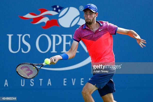 Quentin Halys of France returns a shot against Omar Jasika of Australia during their junior boys' singles final match on Day fourteen of the 2014 US...