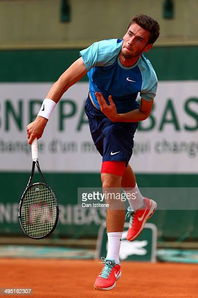 Quentin Halys of France returns a shot during his boys' singles match against Nicolae Frunza of Romania on day eight of the French Open at Roland...