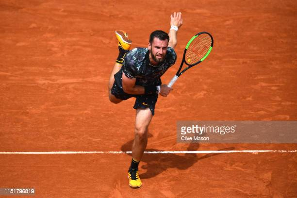 Quentin Halys of France serves in his mens singles first round match against Kei Nishikori of Japan during Day one of the 2019 French Open at Roland...
