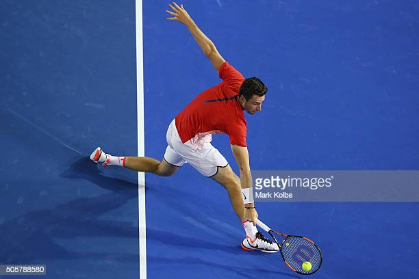 Quentin Halys of France stretches to play a backhand in his second round match against Novak Djokovic of Serbia during day three of the 2016...