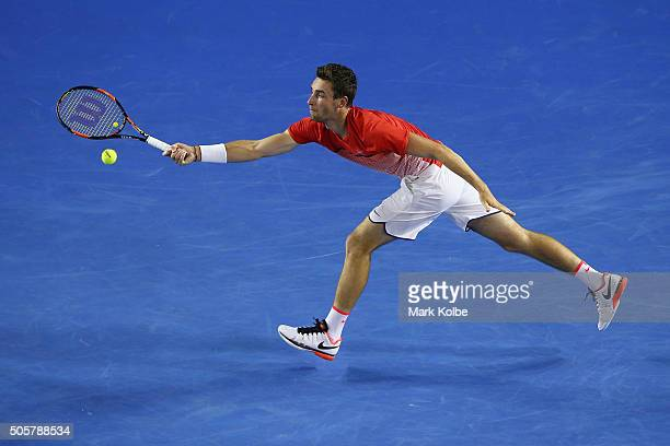 Quentin Halys of France stretches to play a forehand in his second round match against Novak Djokovic of Serbia during day three of the 2016...