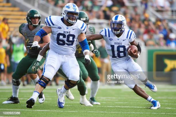 Quentin Harris of the Duke Blue Devils scrambles against the Baylor Bears during the first half of a football game at McLane Stadium on September 15...