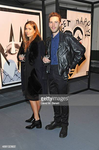 Quentin Jones and Robert Storey attend their exhibition 'The Fractured and the Feline' at The Vinyl Factory Space at the Brewer Street Car Park on...