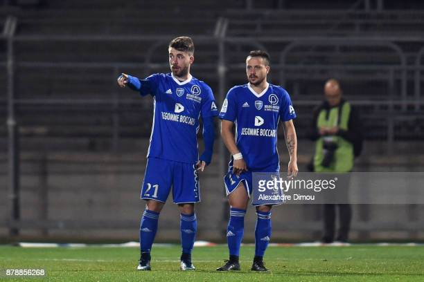 Quentin Martin and Julien Begue of Bourg en Bresse during the Ligue 2 match between Nimes and Bourg en Bresse at Stade des Costieres on November 24...
