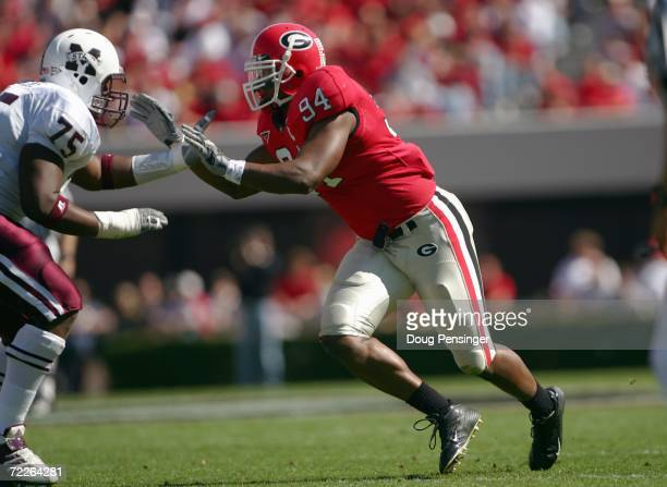 Quentin Moses of the Georgia Bulldogs moves to block Craig Jenkins of the Mississippi State Bulldogs during SEC college football action on October 21...